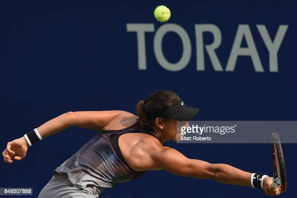 Caroline Garcia of France plays a backhand against Aliaksandra Sasnovich of Belarus during day two of the Toray Pan Pacific Open Tennis At Ariake...