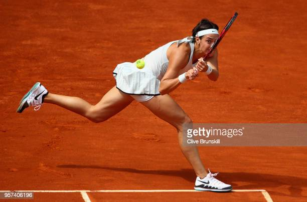 Caroline Garcia of France plays a backhand against Kiki Bertens of the Netherlands in their semi final match during day seven of the Mutua Madrid...