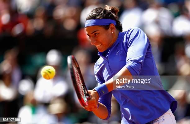 Caroline Garcia of France plays a backhand during ladies singles quarter finals match against Karolina Pliskova of The Czech Republic on day eleven...