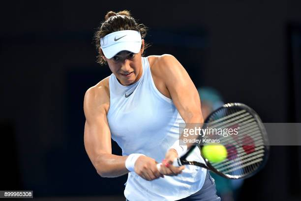Caroline Garcia of France plays a backhand in her match against Alize Cornet of France during day one at the 2018 Brisbane International at Pat...