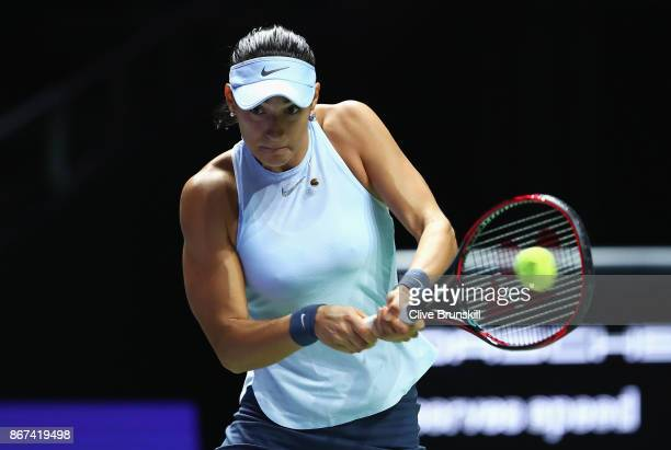 Caroline Garcia of France plays a backhand in her singles semi final match against Venus Williams of the United States during day 7 of the BNP...