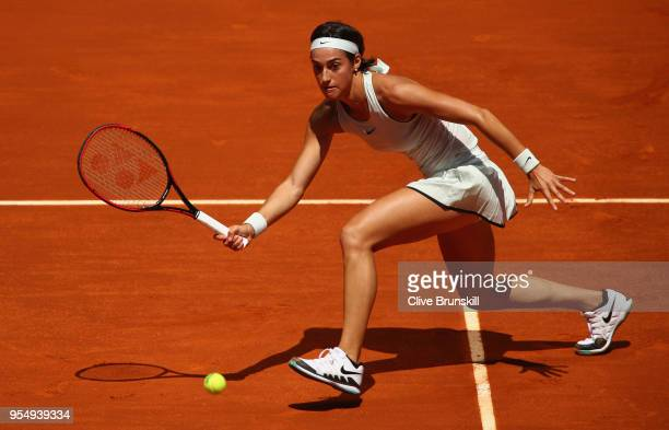 Caroline Garcia of France plays a forehand against Dominika Cibulkova of Slovakia in their first round match during day one of the Mutua Madrid Open...