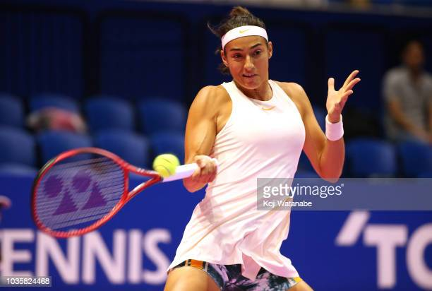 Caroline Garcia of France plays a forehand during her second round match against Anastasia Pavlyuchenkova of Russia on day three of the Toray Pan...