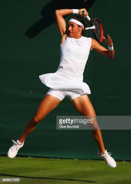 Caroline Garcia of France plays a forehand during the Ladies Singles first round match against Jana Cepelova of Slovakia on day one of the Wimbledon...
