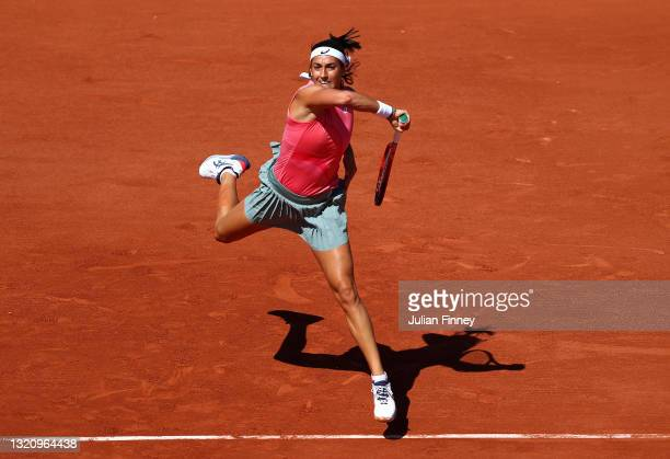 Caroline Garcia of France plays a forehand in their ladies singles first round match against Laura Siegemund of Germany on day two of the 2021 French...