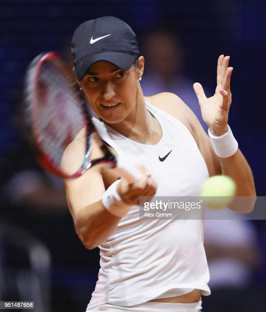 Caroline Garcia of France plays a forehand to Marta Kostyuk of Ukraine during day 4 of the Porsche Tennis Grand Prix at PorscheArena on April 26 2018...