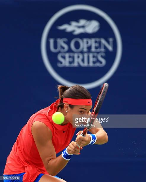 Caroline Garcia of France plays a shot against Simona Halep of Romania during a quarterfinal match on Day 8 of the Rogers Cup at Aviva Centre on...