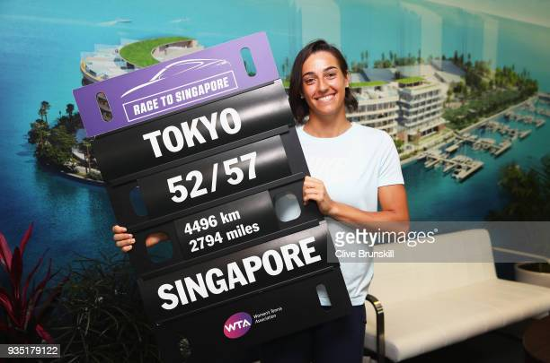 Caroline Garcia of France poses for a photograph with WTA Race to Singapore lapboard at the media all access hour during the Miami Open Presented by...