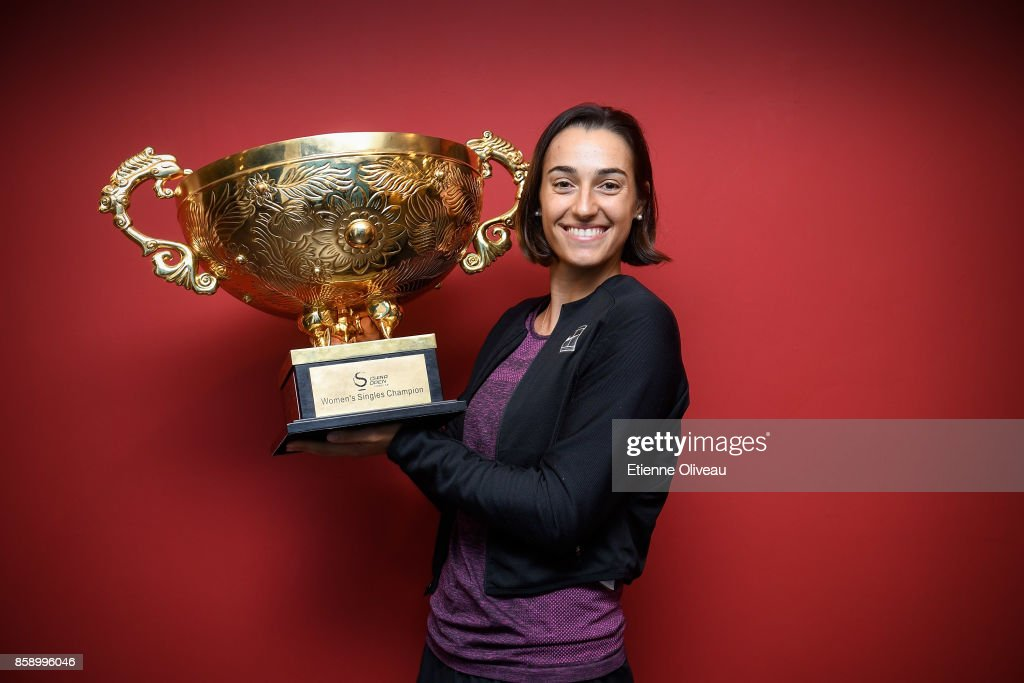 Caroline Garcia of France poses for a picture with the winners trophy after winning the Women's Singles final against Simona Halep of Romania on day nine of the 2017 China Open at the China National Tennis Centre on October 8, 2017 in Beijing, China.