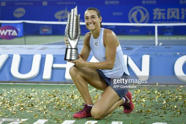 Caroline Garcia of France poses with her trophy after beating Ashleigh Barty of Australia at the women's singles final match at the WTA Wuhan Open...