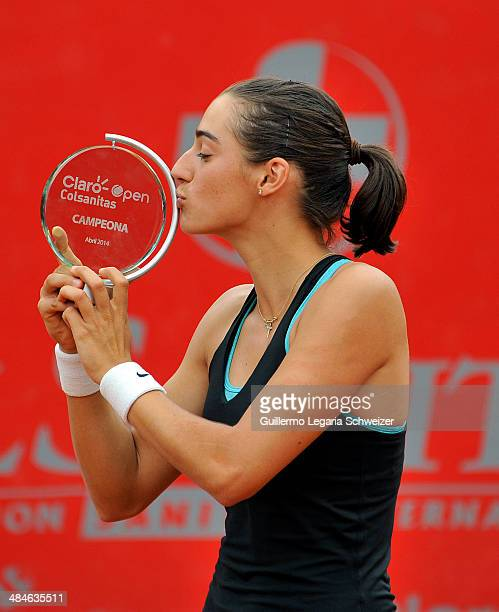 Caroline Garcia of France poses with her trophy after defeating Jelena Jakovic of Serbia 63 64 during their WTA Bogota Open final match at El Rancho...