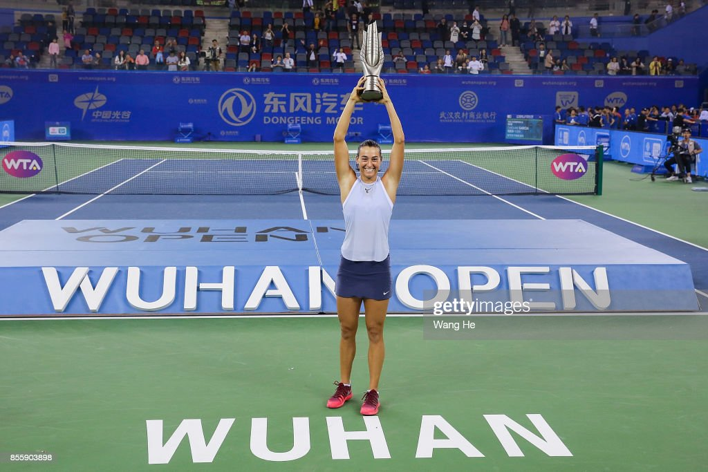 Caroline Garcia of France poses with her trophy after defeating Ashleigh Barty of Australia in the Finals match of Women's Single of 2017 Wuhan Open on September 30, 2017 in Wuhan, China