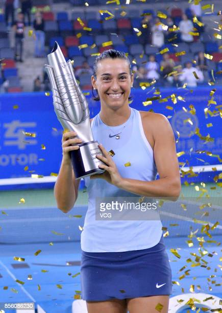 Caroline Garcia of France poses with her trophy after winning the ladies singles final against Ashleigh Barty of Australia on Day 7 of 2017 Dongfeng...
