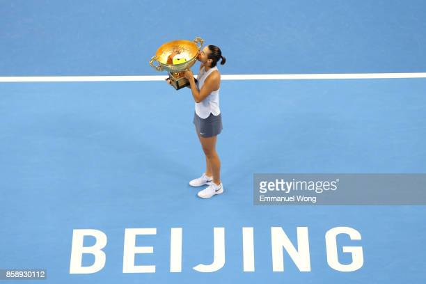 Caroline Garcia of France poses with her trophy after winning the Women's singles final match against Simona Halep of Romania on day nine of the 2017...