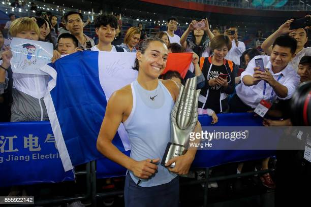 Caroline Garcia of France poses with her trophy and fans after defeating Ashleigh Barty of Australia in the Finals match of Women's Single of 2017...