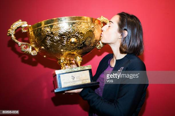 Caroline Garcia of France poses with her trophy for a picture after winning the Women's singles final match against Simona Halep of Romania on day...