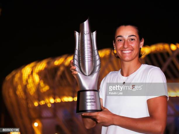 Caroline Garcia of France poses with her trophy outside the stadium after defeating Ashleigh Barty of Australia in the Finals match of Women's Single...