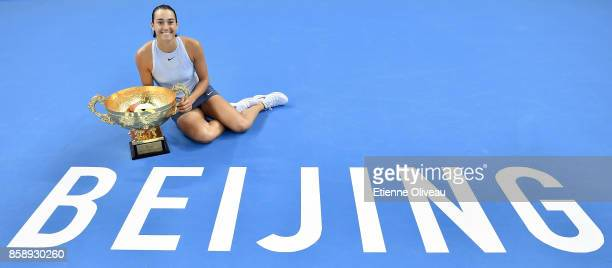 Caroline Garcia of France poses with the winners trophy after winning the Women's Singles final against Simona Halep of Romania on day nine of the...