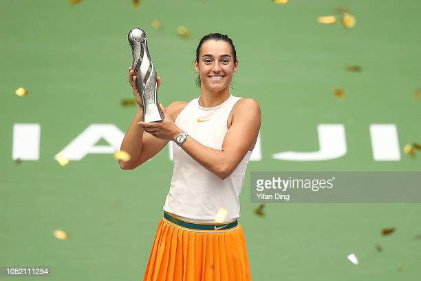 Caroline Garcia of France poses with trophy during victory ceremony after winning the singles final match against Karolina Pliskova of Czech Republic...