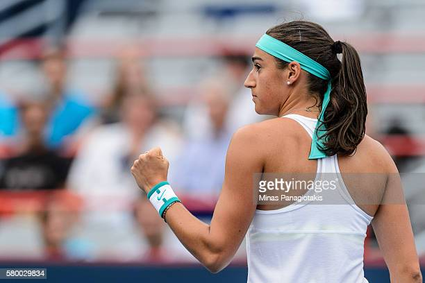 Caroline Garcia of France reacts after winning the first set 62 against Barbora Strycova of Czech Republic during day one of the Rogers Cup at...
