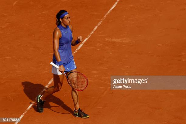 Caroline Garcia of France reacts during the ladies singles second round match against Chloe Paquet of France on day five of the 2017 French Open at...