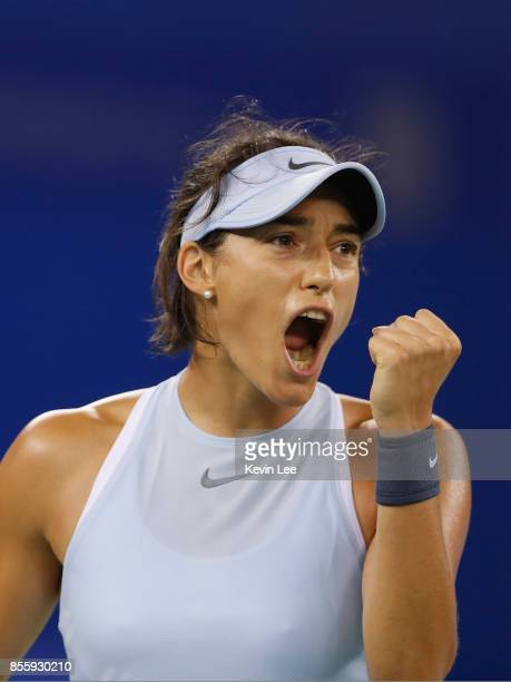 Caroline Garcia of France reacts in the match against Ashleigh Barty of Australia in the Finals match of Women's Single of 2017 Wuhan Open on...