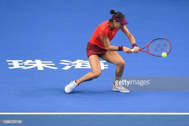 Caroline Garcia of France returns a shot against Aryna Sabalenka of Belarus during their women's singles match on day 4 of the 2018 WTA Elite Trophy...