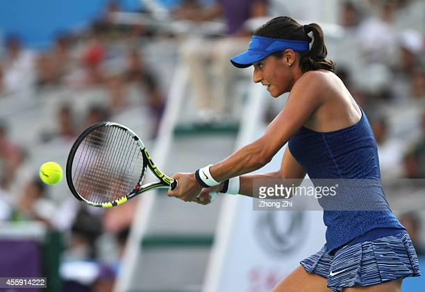 Caroline Garcia of France returns a shot during her match against Agnieszka Radwanska of Poland on day two of 2014 Dongfeng Motor Wuhan Open at...