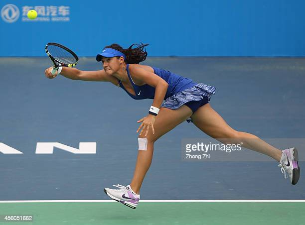 Caroline Garcia of France returns a shot during her match against Coco Vandeweghe of USA on day four of 2014 Dongfeng Motor Wuhan Open at Optics...