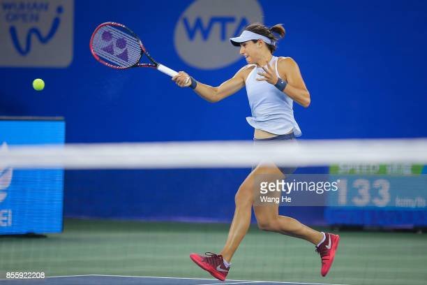 Caroline Garcia of France returns a shot during the Finals match against Ashleigh Barty of Australia on Day 7 of 2017 Dongfeng Motor Wuhan Open at...