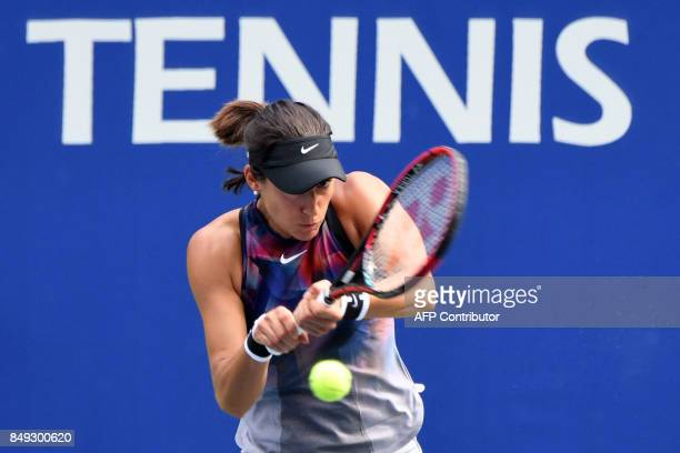 Caroline Garcia of France returns a shot to Aliaksandra Sasnovich of Belarus during their first round women's singles match in the Pan Pacific Open...