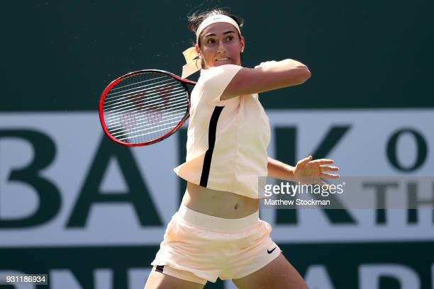 Caroline Garcia of France returns a shot to Daria Gavrilova of Australia during the BNP Paribas Open at the Indian Wells Tennis Garden on March 12...