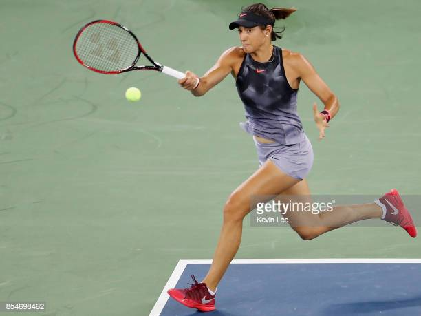Caroline Garcia of France returns a shot to Dominika Cibulkova of Slovakia at round 3 of Women's Single of 2017 Wuhan Open during Day 4 on September...