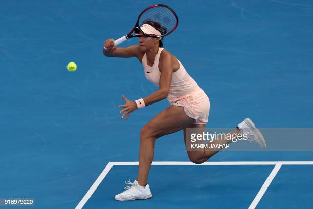 Caroline Garcia of France returns the ball to Garbine Muguruza of Spain as they compete in their singles match during the quarterfinal round of the...