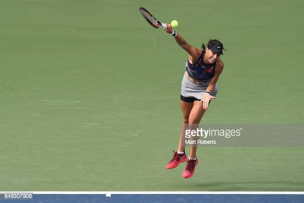 Caroline Garcia of France serves against Aliaksandra Sasnovich of Belarus during day two of the Toray Pan Pacific Open Tennis At Ariake Coliseum on...