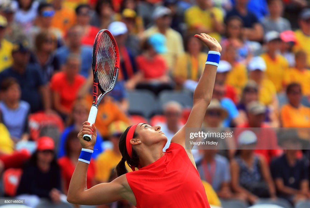 Caroline Garcia of France serves against Simona Halep of Romania during a quarterfinal match on Day 8 of the Rogers Cup at Aviva Centre on August 12, 2017 in Toronto, Canada.
