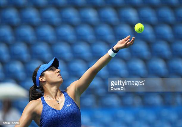 Caroline Garcia of France serves during her match against Coco Vandeweghe of USA on day four of 2014 Dongfeng Motor Wuhan Open at Optics Valley...