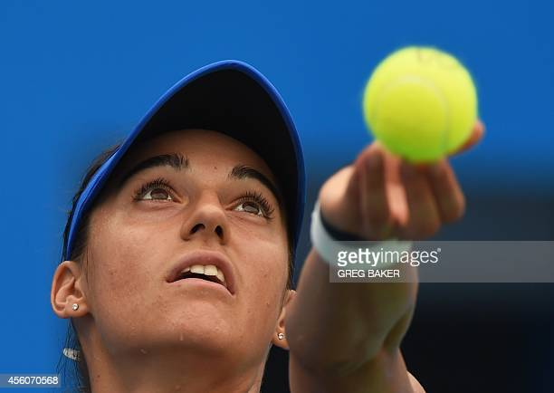 Caroline Garcia of France serves during her quarterfinal match against Petra Kvitova of the Czech Republic at the Wuhan Open tennis tournament in...