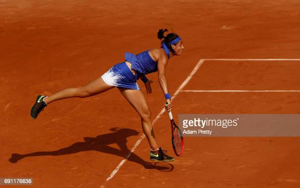 Caroline Garcia of France serves during the ladies singles second round match against Chloe Paquet of France on day five of the 2017 French Open at...