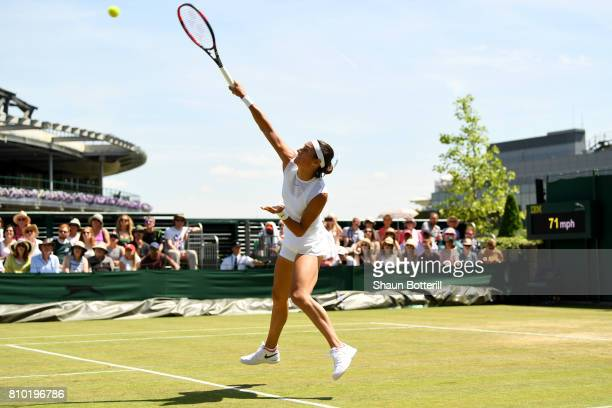 Caroline Garcia of France serves during the Ladies Singles third round match against Madison Brengle of The Unites States on day five of the...
