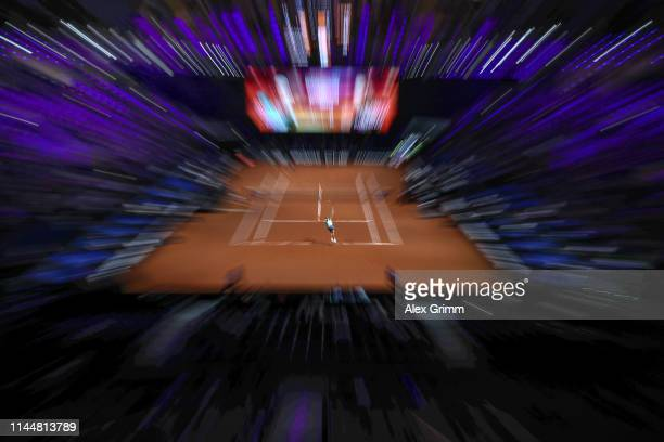 Caroline Garcia of France serves the ball to Anett Kontaveit of Estonia during their first round match on day 3 of the Porsche Tennis Grand Prix at...
