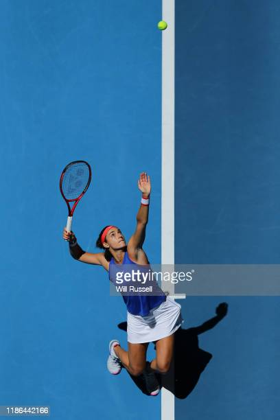 Caroline Garcia of France serves to Ash Barty of Australia in the 2019 Fed Cup Final tie between Australia and France at RAC Arena on November 09...