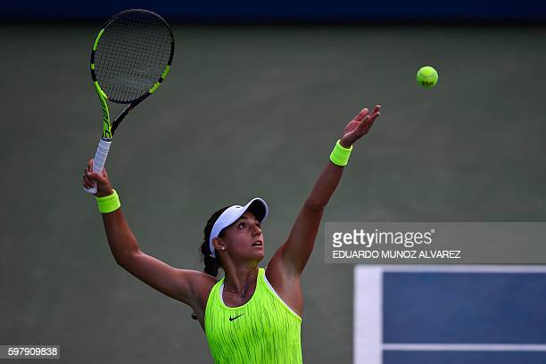 Caroline Garcia of France serves to Pauline Parmentier of France during their 2016 US Open Women's Singles match at the USTA Billie Jean King...