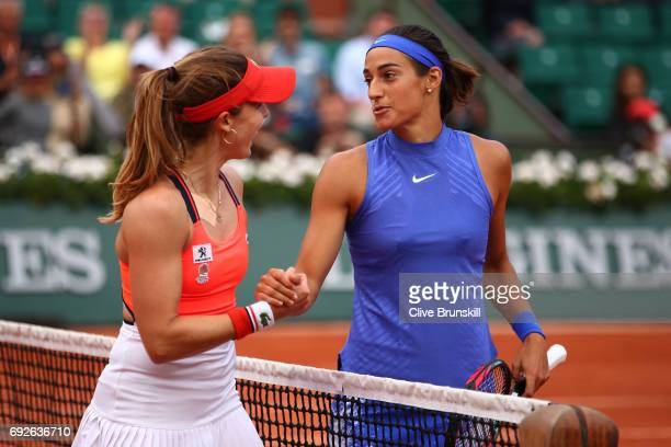 Caroline Garcia of France shakes hands with Alize Cornet of France following her victory during their ladies singles fourth round match on day nine...