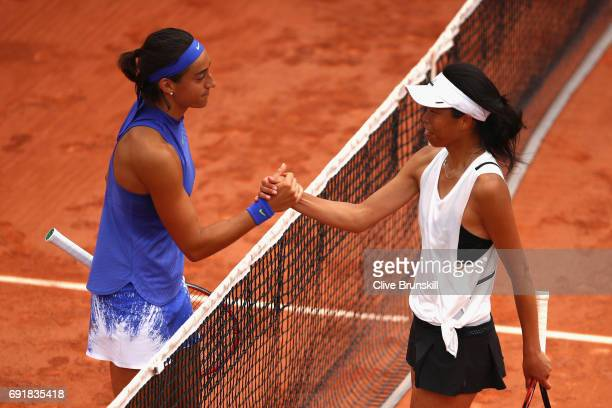 Caroline Garcia of France shakes hands with her opponant following victory in the ladies singles third round match against SuWei Hsieh of Taipei on...