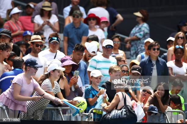 Caroline Garcia of France signs autographs for fans after her third round match against Aliaksandra Sasnovich of Belarus on day six of the 2018...