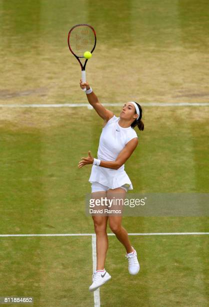 Caroline Garcia of France smashes the ball during the Ladies Singles fourth round match against Johanna Konta of Great Britain on day seven of the...