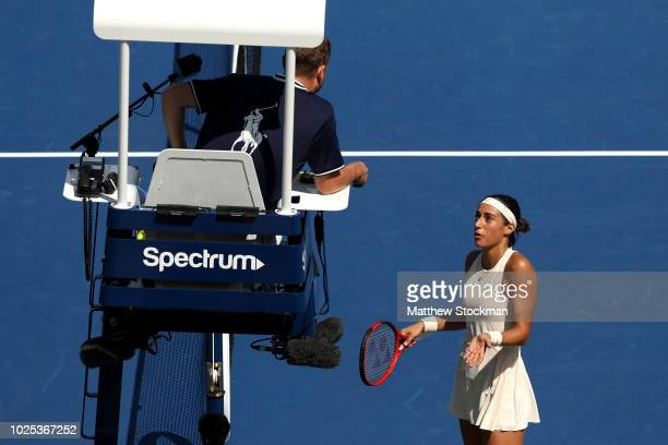Caroline Garcia of France speaks with the umpire during her women's singles second round match against Monica Puig of Puerto Rico on Day Four of the...