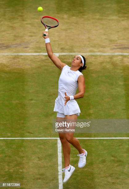 Caroline Garcia of France stretches for the ball during the Ladies Singles fourth round match against Johanna Konta of Great Britain on day seven of...