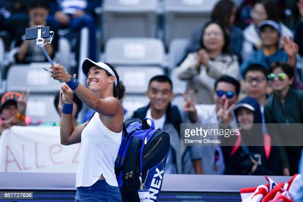 Caroline Garcia of France takes a selfie with fans after her Women's singles third round match against Alize Cornet of France on day six of the 2017...